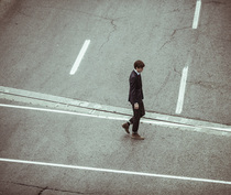 Businessman crossing street